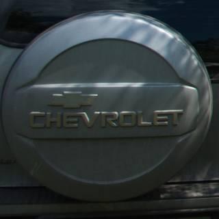 Потерян колпак на заднее колесо Шевроле-Нива, цвет серебристый